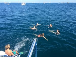 The gaggle of kids swimming at Bahia Santa Maria.